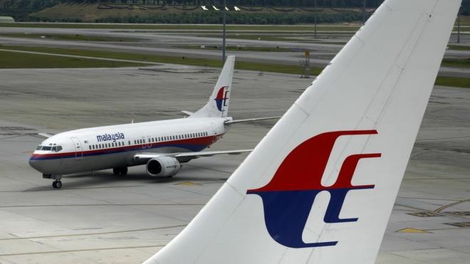 May bay Malaysia Airlines ha canh khan vi su co tren khong hinh anh