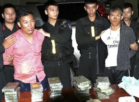 Van chuyen thue 30 banh heroin de lay 100 trieu dong hinh anh 1
