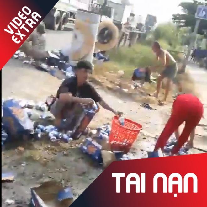 Lat xe cho bia o Tien Giang, mot so nguoi loi dung 'hoi cua' hinh anh