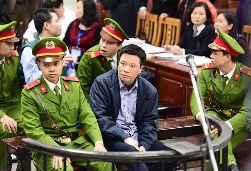 Vu xu Ha Van Tham: Dai dien Ngan hang Nha nuoc khat cau tra loi hinh anh 1
