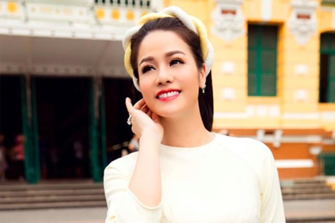 Nhat Kim Anh dien ao dai, khoe giong hat ngot ngao hinh anh