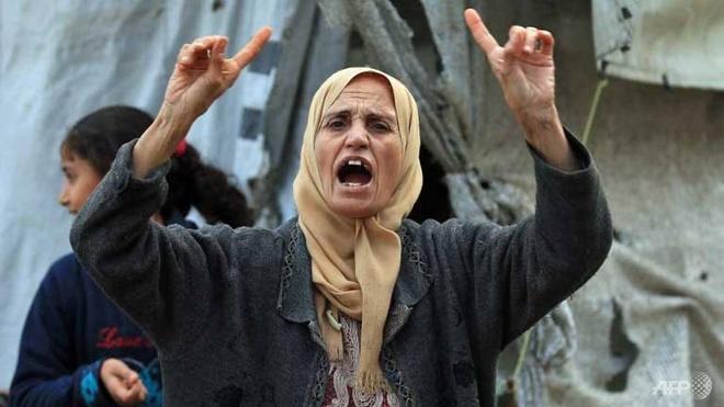 Nguoi Palestine va thoi khac tam toi tren manh dat que huong hinh anh