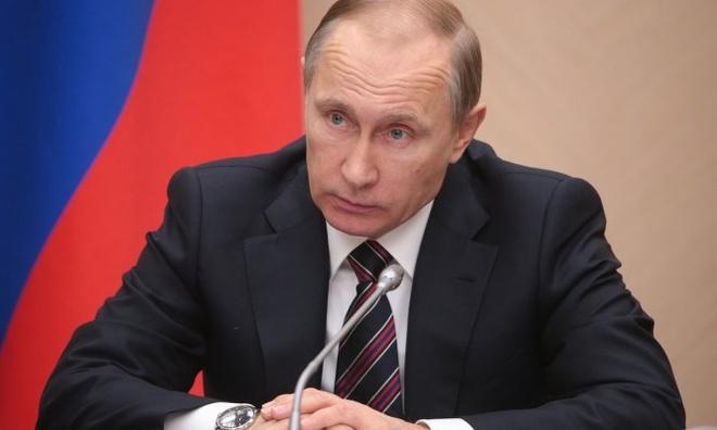 Tong thong Putin cong bo Nga da san xuat duoc vac xin Ebola hinh anh