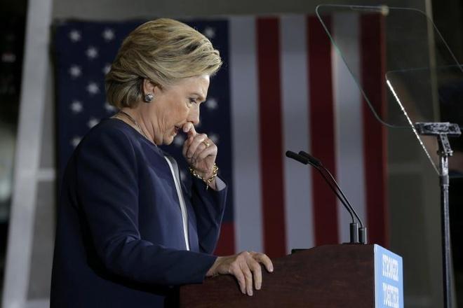 Clinton nhan qua trieu do tu Qatar anh 1