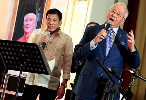 Tong thong Duterte song ca cung thu tuong Malaysia hinh anh