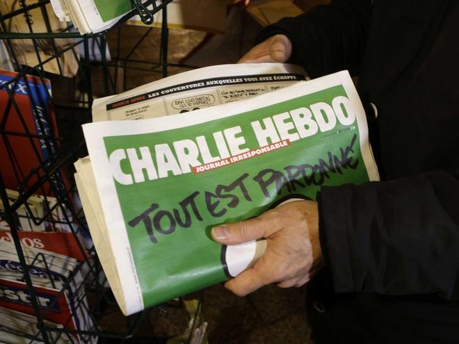 Charlie Hebdo lai dang tranh cham biem Hoi giao hinh anh