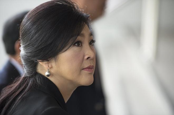 Canh sat dieu tra xe bi nghi giup ba Yingluck bo tron hinh anh