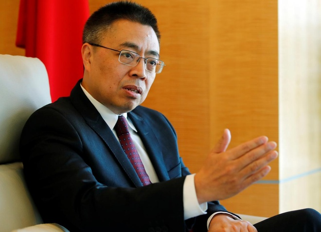Dai su Trung Quoc va My 'dau to' nhau kich liet tai WTO hinh anh 2