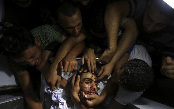 Hinh anh cua nam 2014: Mau nhuom do dai Gaza hinh anh 8