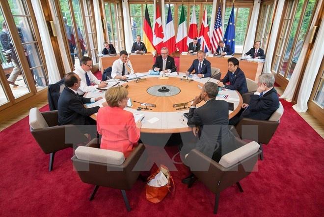 G7 ra Tuyen bo chung phan doi Trung Quoc xay dao o Bien Dong hinh anh 1 Các đại diện cấp cao G7 tại cuộc gặp. (Nguồn: AFP/TTXVN)