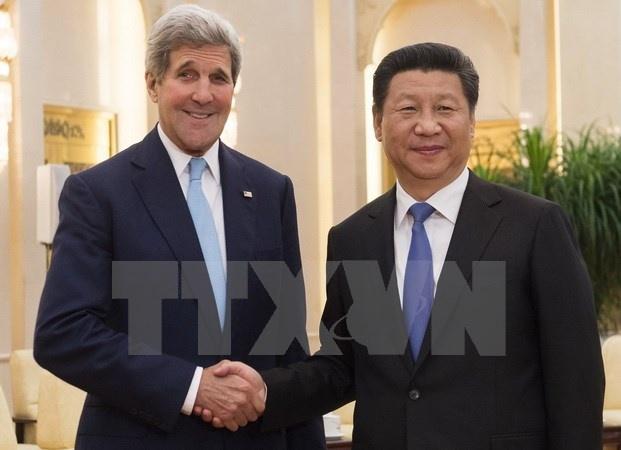 Trung Quoc cam ket xay dung quan he nuoc lon kieu moi voi My hinh anh 1 Chủ tịch Trung Quốc Tập Cận Bình (phải) và Ngoại trưởng Mỹ John Kerry. (Ảnh: AFP/TTXVN)