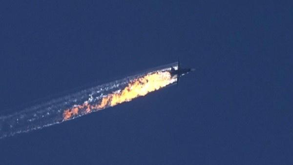 Nga trung phat Tho Nhi Ky: Gay ong dap lung ong? hinh anh 2 Máy bay Nga bốc cháy vì trúng tên lửa của Thổ Nhĩ Kỳ. Ảnh: Getty