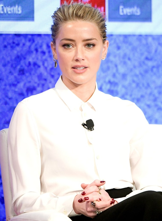 Amber Heard luong tinh anh 1