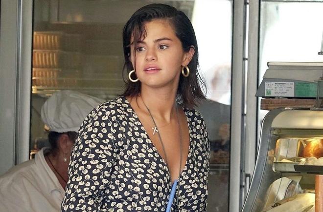 Justin Bieber quan quyt ban gai moi, Selena Gomez vui ve di du lich hinh anh