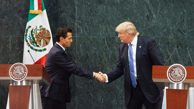 TT Trump len tieng ve viec goi dan nhap cu trai phep la 'thu vat' hinh anh 1