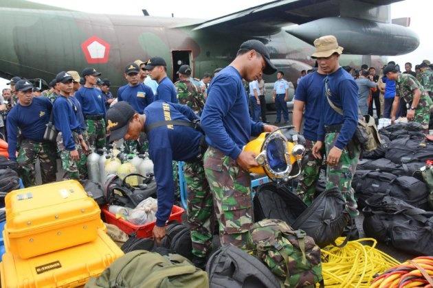 Hai thi the nan nhan QZ8501 ve dat lien hinh anh 35 Nhập mô tả cho ả