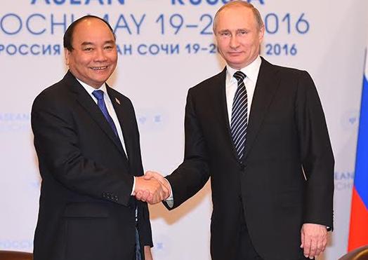 Ong Putin: Tranh chap Bien Dong can giai quyet bang luat hinh anh
