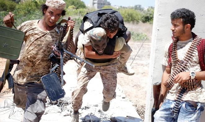 Canh giao tranh mot mat, mot con voi IS o Libya hinh anh 4
