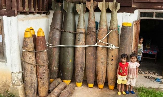 Thuyen, chuong, thung tu bom thoi chien o Lao hinh anh
