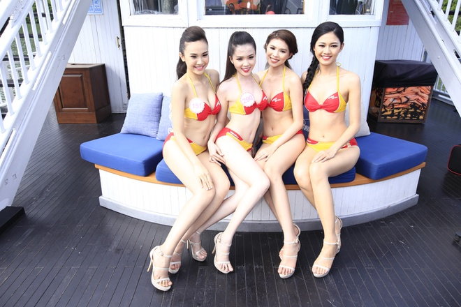 Dan thi sinh HHVN khoe sac trong trang phuc bikini Vietjet hinh anh 5