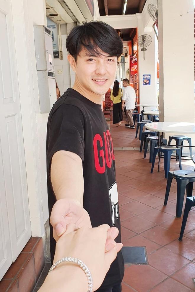 Dong Nhi - Ong Cao Thang khoe anh di nghi tuan trang mat hinh anh 1