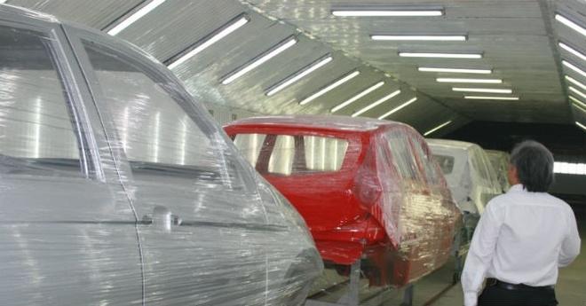 Ban nha may tra no, Vinaxuki vi dau nen noi? hinh anh 2 Nhà máy sản xuất ôtô tại Mê Linh (Hà Nội) hoạt động cầm chừng trong một thời gian dài.