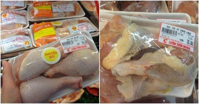 Đùi tỏi gà Việt Nam có giá 77.900 đồng/kg sau khi khuyến mại giảm giá (bên trái), đùi tỏi gà Mỹ đông lạnh có giá 48.500 đồng/kg (bên phải) tại Big C Thăng Long.