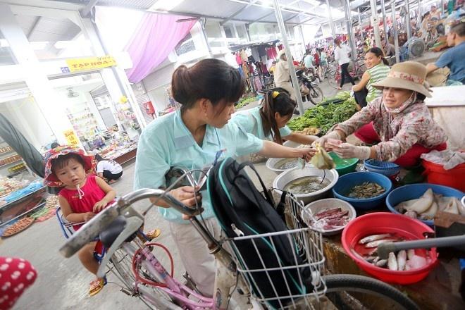 Muc luong va doi song cong nhan: Khong lam them thi doi! hinh anh