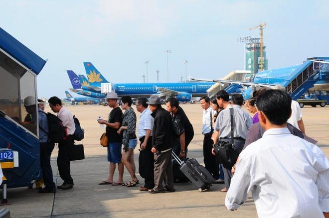 Bo truong Thang: 'Giam gia ve may bay cho ba con nho' hinh anh