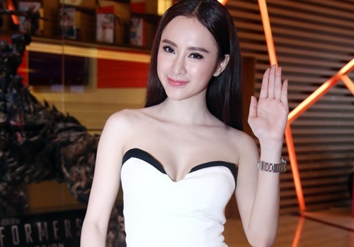 Angela Phuong Trinh tiep tuc dien vay nhai di tiec hinh anh