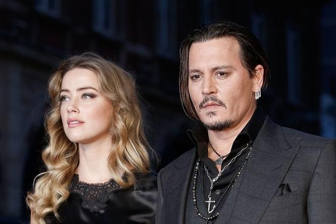 Johnny Depp va vo cu Amber Heard tiep tuc loi qua tieng lai hinh anh 2