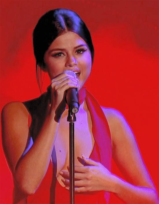 Selena Gomez bi che hat kem hinh anh 1 Cuối tuần qua, Selena Gomez có show diễn trong chương trình gây quỹ từ thiện Children In Need phát sóng trực tiếp trên đài BBC của Anh. Nữ ca sĩ trẻ mang đến ca khúc mới nằm trong album vừa phát hành Revival kèm theo trang phục đỏ gợi cảm.