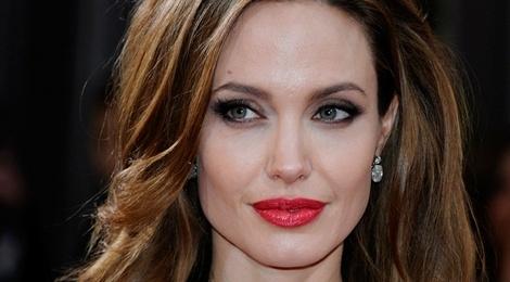 Angelina Jolie, Thanh Long la sao duoc ham mo nhat the gioi hinh anh