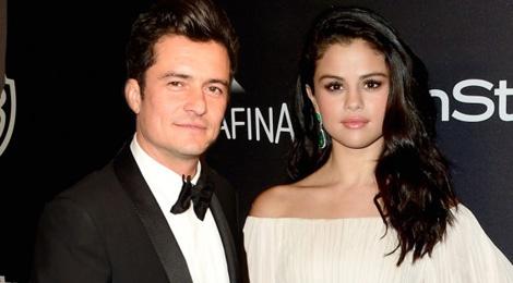 Orlando Bloom hon Selena Gomez trong hop dem hinh anh