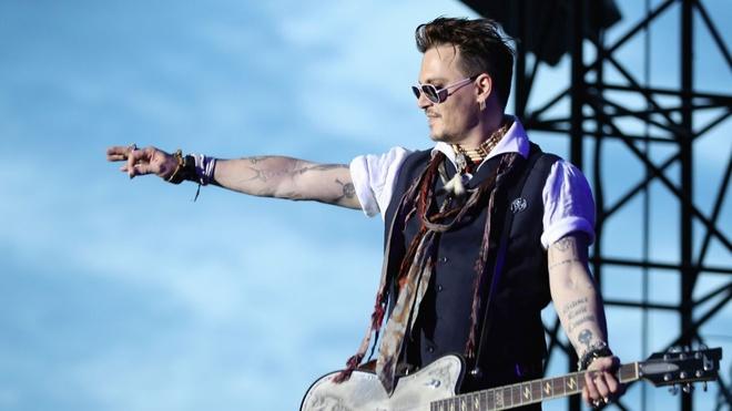 Johnny Depp tranh quyen nuoi cho cung voi vo tre hinh anh 2