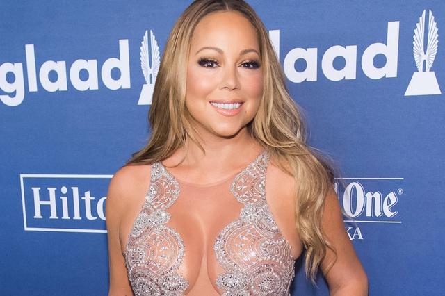 Anh pho nguc cua Mariah Carey o san bay bi go hinh anh 2