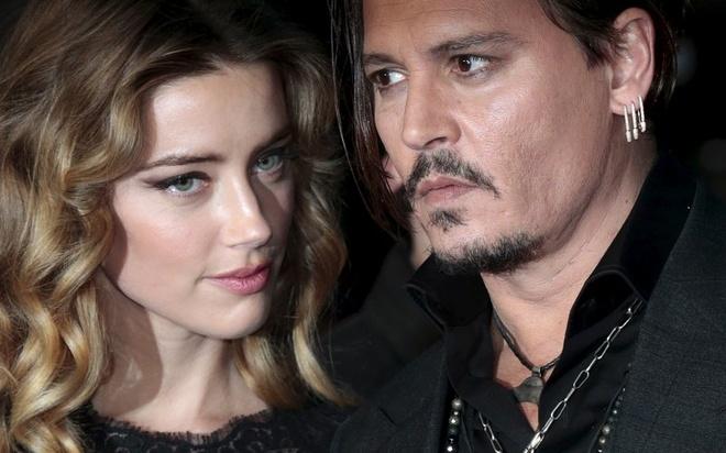 Johnny Depp chap nhan chi 7 trieu USD de thoat khoi vo cu hinh anh