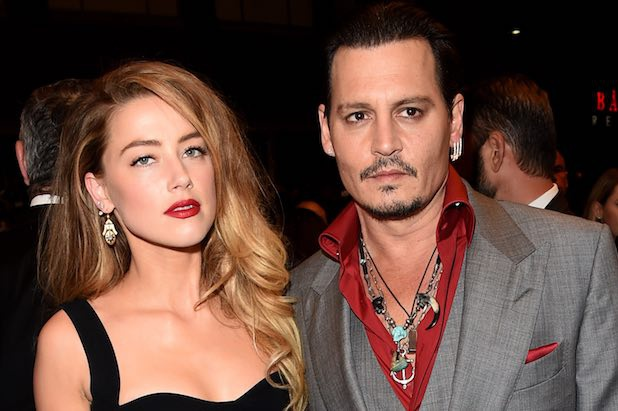 Amber Heard tiep tuc doi tien Johnny Depp sau ly hon hinh anh 1