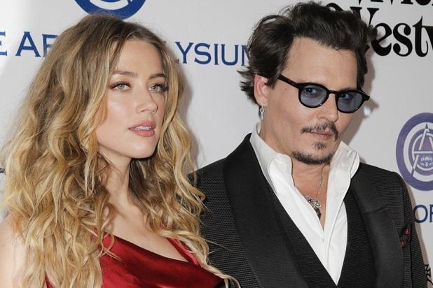 Hau ly hon, Amber Heard nhan 7 trieu USD cung bay thu cung hinh anh