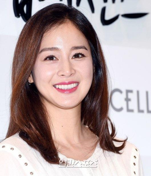 Kim Tae Hee dien ao rong giau bung bau hinh anh 4