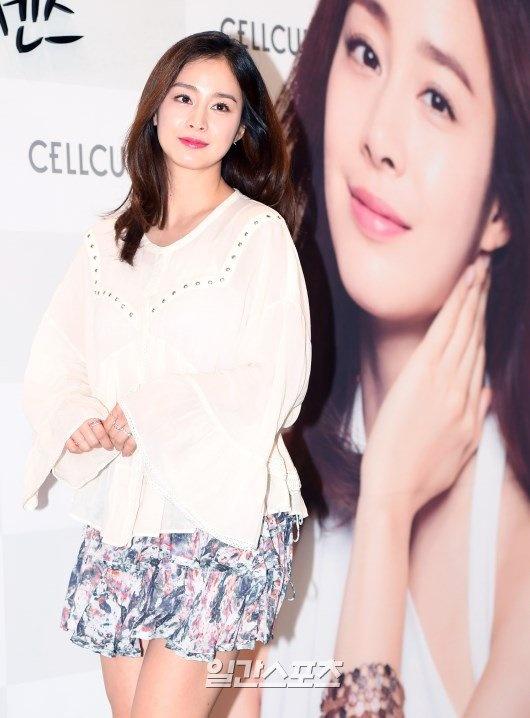 Kim Tae Hee dien ao rong giau bung bau hinh anh 5