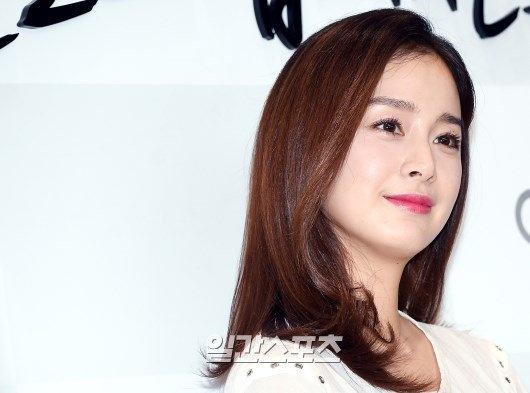 Kim Tae Hee dien ao rong giau bung bau hinh anh 6
