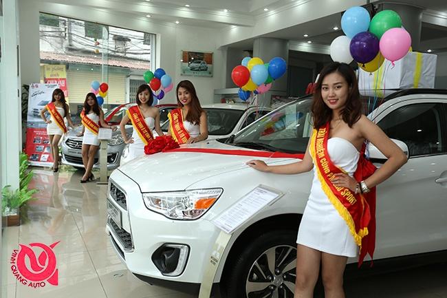 Mitsubishi Vinh Quang oto to chuc ngay hoi ban hang, lai thu hinh anh 2