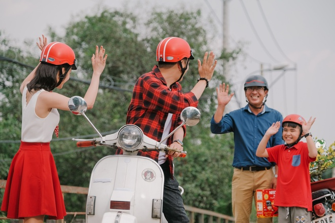 Dong Nhi, Ngo Kien Huy tro tai nau banh tet trong MV moi hinh anh 7