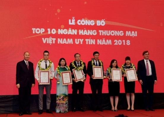 Loi nhuan 2017 cao nhat he thong, Vietcombank lan 2 lot top NH uy tin hinh anh 1