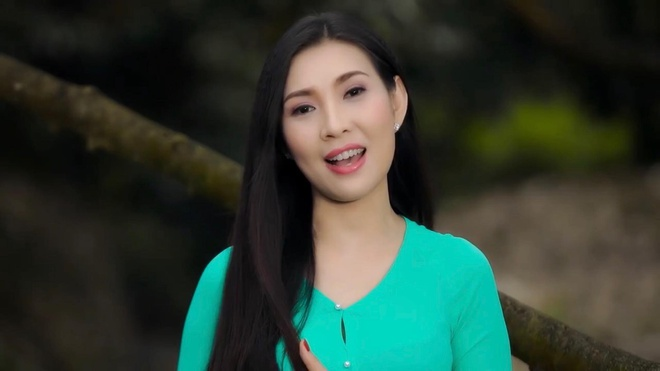 Mai Le Quyen hoa than thanh co gai ban sau rieng trong MV moi hinh anh 1