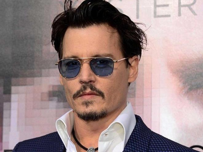 Fan the gioi phu thuy phan ung trai nguoc ve Johnny Depp hinh anh