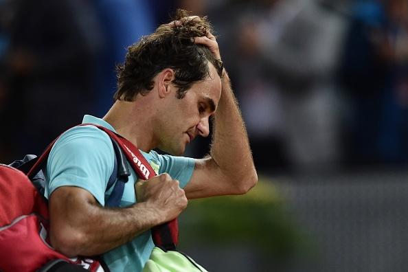 Bo lo 2 match-point, Federer bi loai som o Madrid Open hinh anh