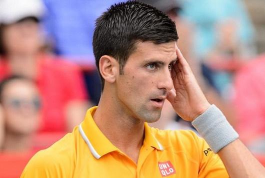 Djokovic chong mat vi hit phai mui can sa hinh anh