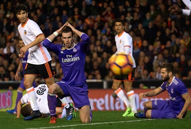 Ronaldo lap cong, Real van bai tran truoc Valencia hinh anh 11
